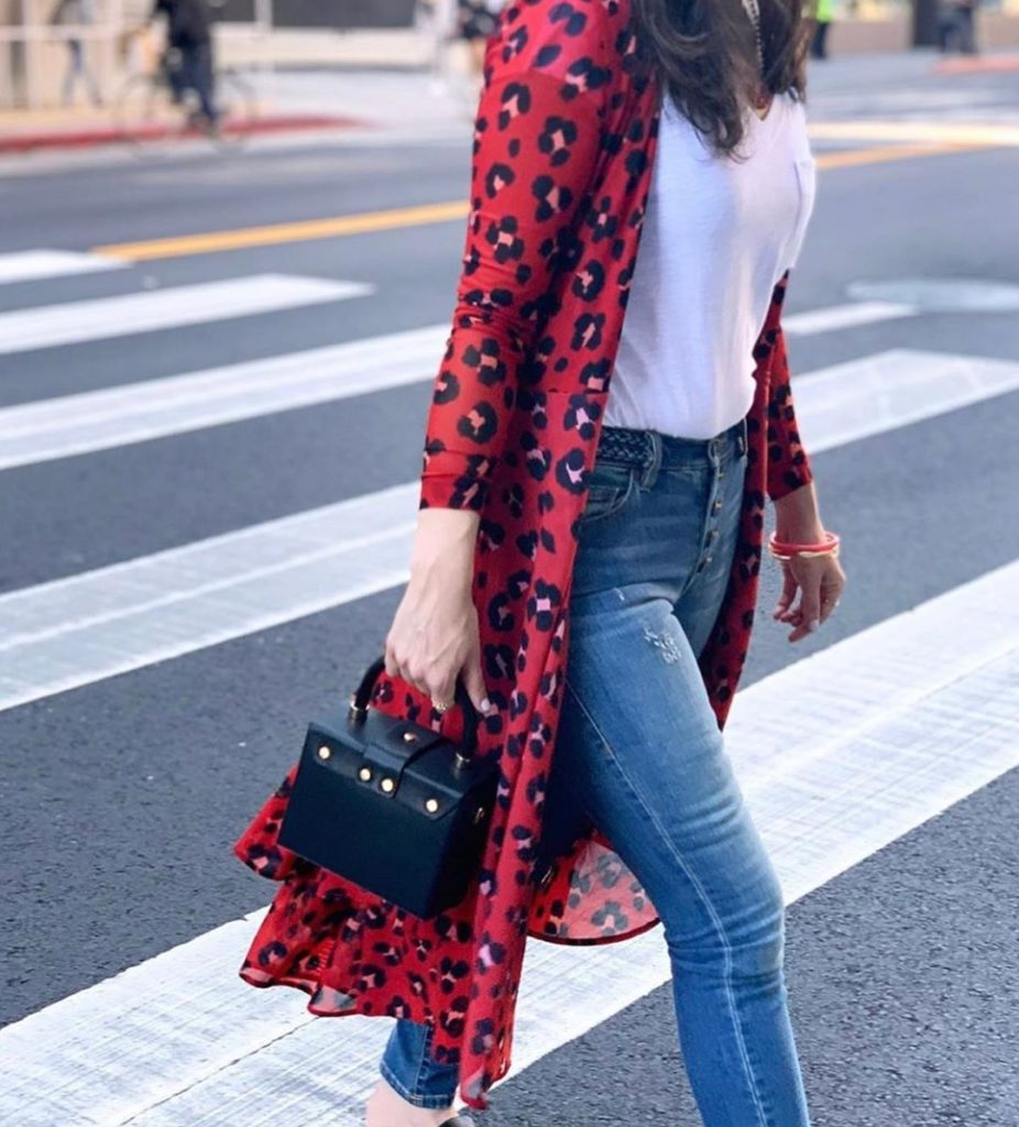 woman on street in red leopard print shirt