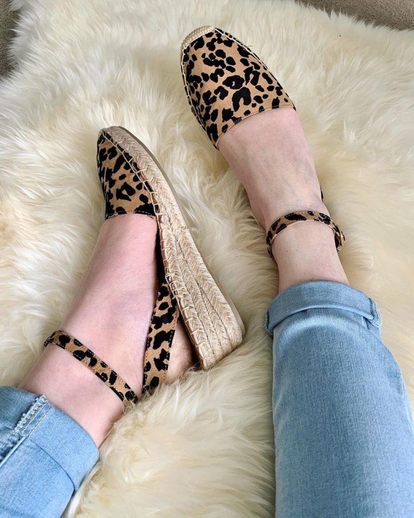 legs in leopard print shoes