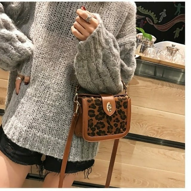 woman with leopard print purse
