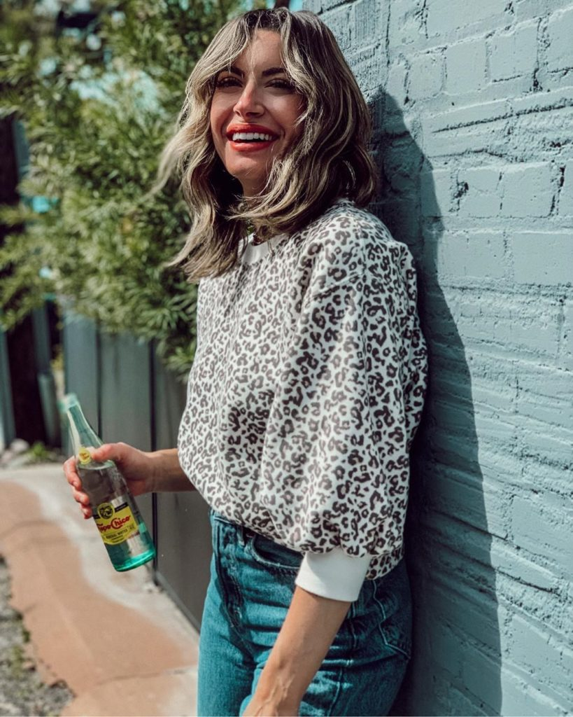 smiling woman in leopard print blouse