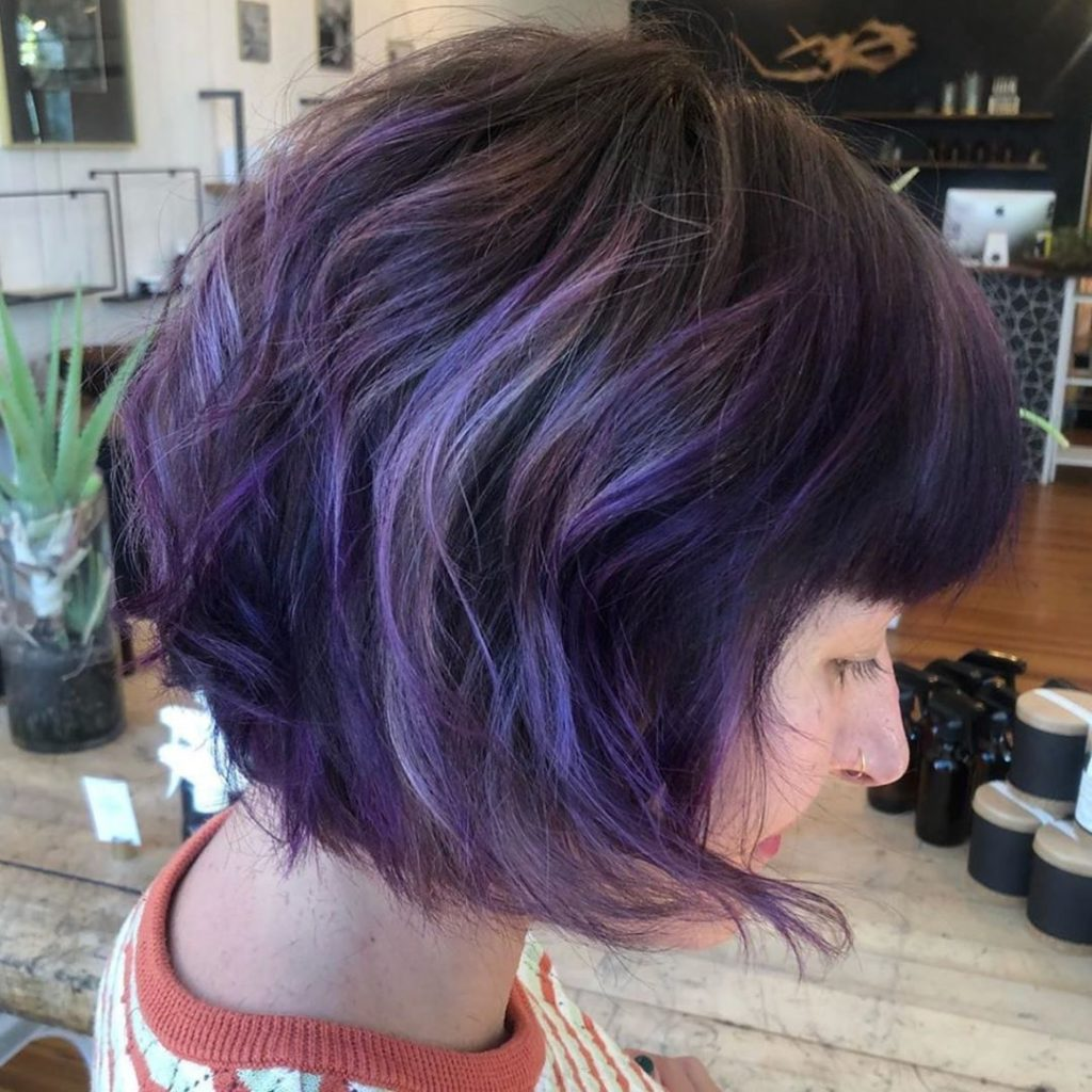 woman in her 40's with purple hair